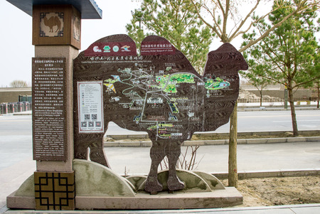 camel post: DUNHUANG,CHINA-MARCH 11: Guide map of Mingshashan desert camel shape on March 11, 2016 in Dunhuang, China. Editorial