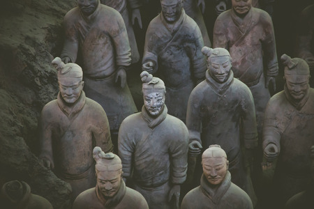 terra: CHINA, XIAN - MARCH 14: Ping Ma Yong, Terra cotta army on 14 March 2016 in Xian, China. Unesco world heritage site. Soldier  funerary statues in vintage tone Editorial