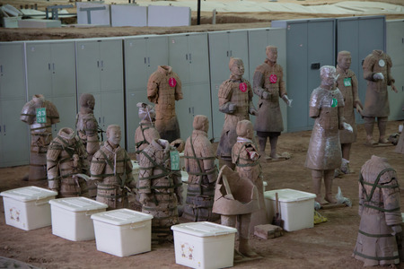 terra: CHINA, XIAN - MARCH 14: Ping Ma Yong, Terra cotta army on 14 March 2016 in Xian, China. Unesco world heritage site. Soldier  funerary statues.