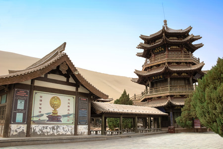 crescent lake: DUNHUANG,CHINA-MARCH 11:  Mingyue Pavilion in Crescent lake, a part of silk road on March 11, 2016 in Dunhuang, China.