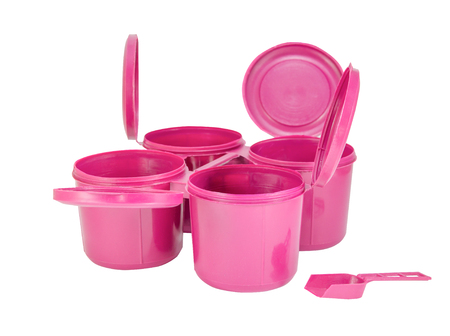contiguous: Pink plastic joint boxs set and spoon with clipping path Stock Photo
