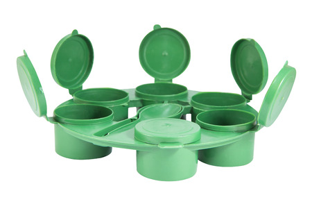 contiguous: Green plastic joint boxes set and spoon with clipping path Stock Photo