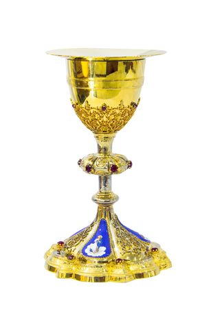Gold chalice with plate on white background Stock Photo