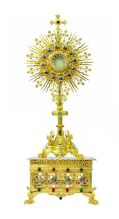 Antique gold monstrance on the pedestal engraving 4 saints on white background
