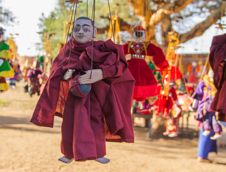 Myanmar traditional handicraft monk puppet hanging