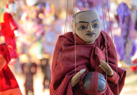 Myanmar traditional handicraft monk puppet hanging