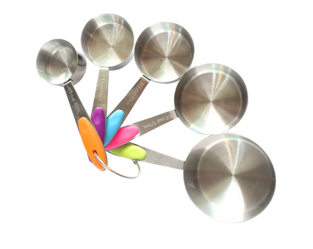 Set of stainless steel measuring spoons on white background with clipping path Stock Photo