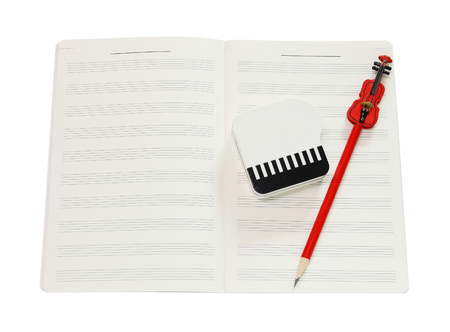 Music notation book and red violin pencil with clipping path