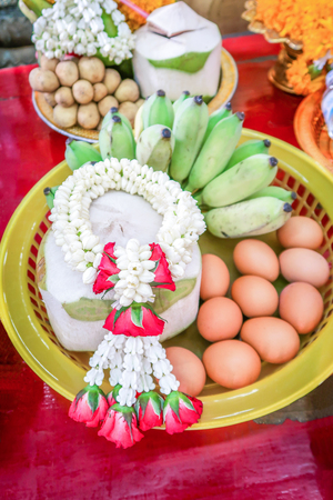 Boiled eggs coconut and banana in basket to oblation vow, traditional ceremony in Thailand