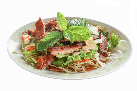 mea: Sliced grilled beef salad, Thai food in green dish on white background