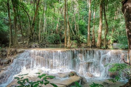 Huay Mae khamin waterfall in National Park Srinakarin dam, Kanchanaburi, western of Thailand in dark tone Stock Photo