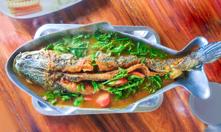 striped snakehead fish: Sour soup with fried striped snake-head fish, Kang Som is Thai name Stock Photo
