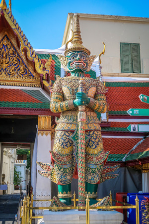 Giant statue in Wat Phra Keaw, Royal Grand Palace in Bangkok Thailand