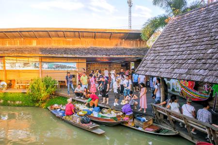 15 DECEMBER 2018, PATTAYA, CHONBURI, THAILAND:  Tourist are travel in Pattaya Floating Market four regions in the evening