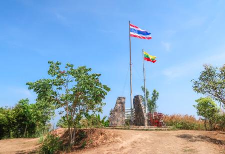KANCHANABURI PROVINCE, THAILAND - APRIL 16, 2019:  Thai and Myanmar Flag at border of Thailand and Myanmar , Ban I-Tong, Thong Pha Phum, Kanchanaburi, Thailand.