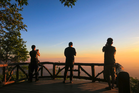 KANCHANABURI PROVINCE, THAILAND - MARCH 30, 2019: People take photos sunrise at viewpoint, Thong Pha Phum National Park, Kanchanaburi, Thailand