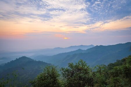 The natural landscape in the morning of mountains with sunrise