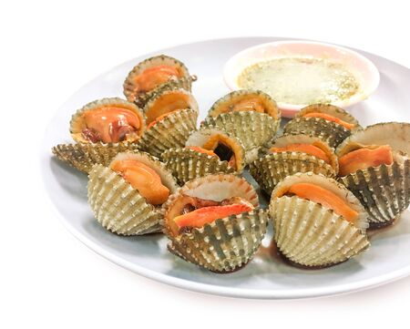 Steamed cockles with spicy seafood sauce on white background