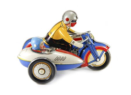 Motorrad-Uhrwerk-Blechspielzeug auf weißem Hintergrund Standard-Bild
