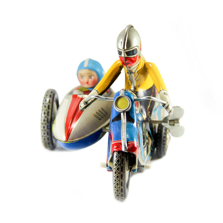 Motorcycle clockwork tin toy on white background