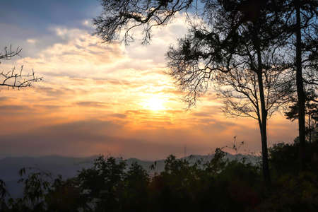 The landscape of natural mountains and hill with sunrise, trees are silhouette