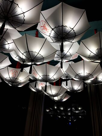 Lamps, unusual ceiling lamps in the form of umbrellas. Modern interior lighting design