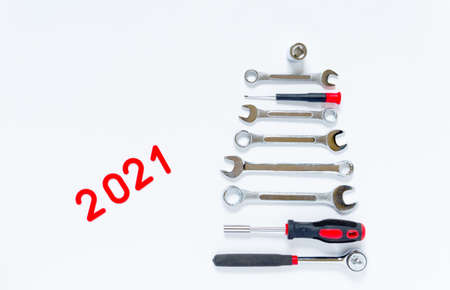 Christmas tree made of construction tools on a white background. New Year Concept for auto workshop. New Year Concept 2021 Imagens