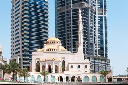 DUBAI, UAE - MAY 5,2017: Modern buildings and Al Raheem mosque on the marina walk in Dubai Marina on may 5, 2017, Dubai, UAE.