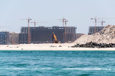 DUBAI, UAE - MAY 5,2017: Construction and construction machinery in front of Dubai Marina in a spring day, United Arab Emirates on may 5, 2017, Dubai, UAE. Editorial