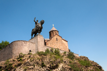 Metekhi Church and equestrian statue of King Vakhtang Gorgasali close-up on a summer day, Tbilisi, Georgia