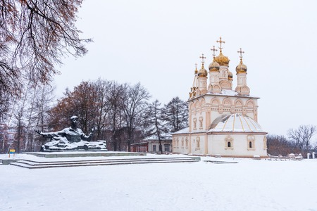 Winter view of the monument to the Russian poet Sergei Yesenin and the Savior Transfiguration Church in Yara in Ryazan, Russia.
