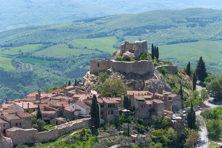 Amazing panoramic view of the Castiglione d'Orcia. Beautiful landscape in Tuscany, Italy. Fortress on the hill. The small typical town in Val d'Orcia, Tuscany.