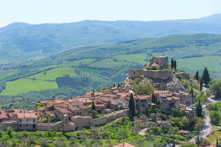 Amazing panoramic view of the Castiglione dOrcia. Beautiful landscape in Tuscany, Italy. Fortress on the hill. The small typical town in Val dOrcia, Tuscany.