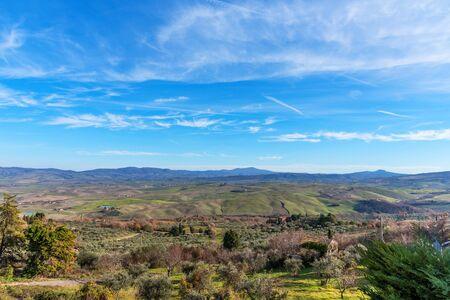 Amazing winter view of Tuscany, Italy. Picturesque winter landscape view of Tuscany with stone houses, colorful hills, fields and vineyards in Italy.