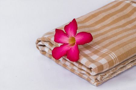 The Red flowers lay on brown cloth photo