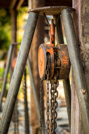 The Chain hoist with a large wooden pole. photo