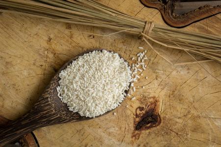Wooden Spoon rice, wood floors, brown, jasmine rice, surface. photo