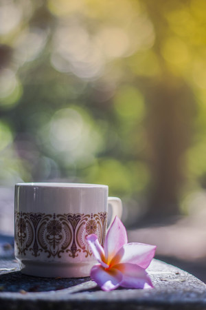 decaf: blurred background, flower vase with cups coffee in coffee shop, background and textures. blurred and soft focus on vintage color style.