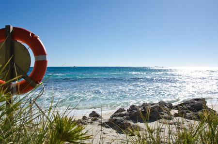 beach buoy: Life Buoy and beautiful beach of Rottnest Island Western Australia