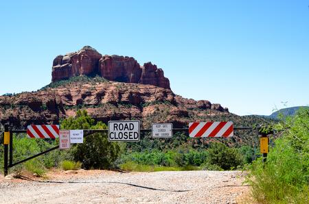 hoodoos: Trespassing block road signs red canyon at Red Rock Cliff Hoodoos Stock Photo
