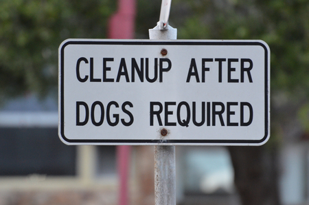 awareness sign of clean up after dogs required Banco de Imagens