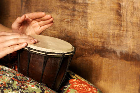 Playing on the djembe drum  photo