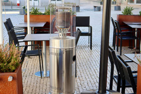 Gas heater on the outdoor cafe terrace, daytime shot.