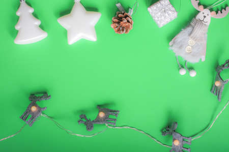 Christmas layout white and silver Christmas toys Christmas tree star deer cone gift garland green background