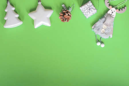 Christmas layout Christmas toys Christmas tree star deer cone gift green background