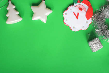 Christmas layout Christmas toys Christmas tree star gift Santa Claus green background Stock Photo