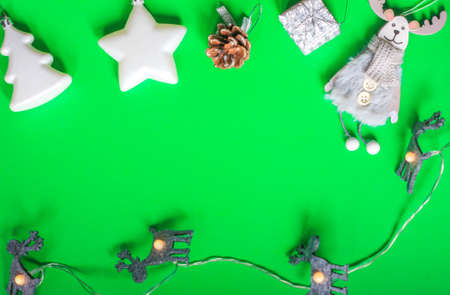 Christmas layout Christmas toys Christmas tree star deer cone gift garland green background