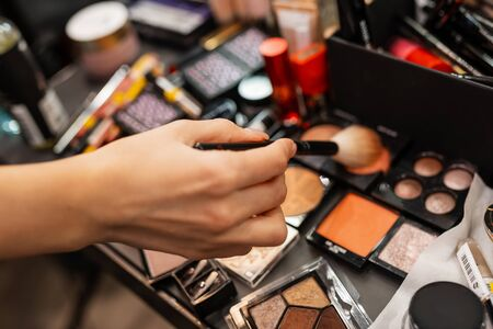 Make-up artist work in a beauty salon. Cosmetics for makeup. Makeup artist does makeup. Close-up of hands and cosmetics Stock Photo