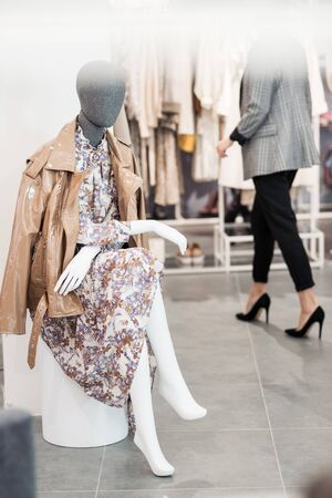 Female mannequin in clothes in the interior of the sclothing store. Stock Photo