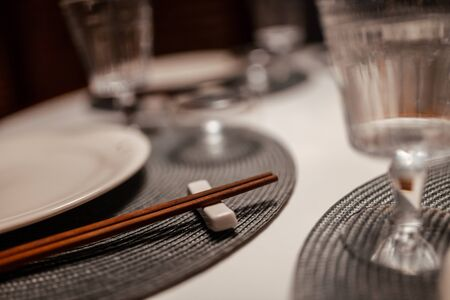 Table setting in a chinese restaurant. Close-up of Chinese chopsticks on a table